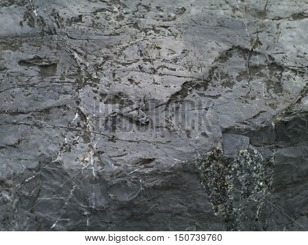 closeup shot of rough grey stone texture background