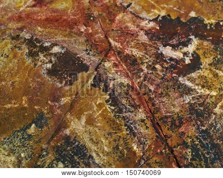 closeup shot of rough and grainy colourful stone texture
