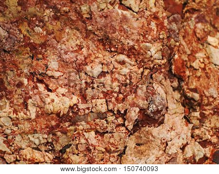 closeup shot of rough and cracked brown-red stone texture