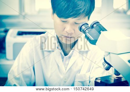 asia scientist working in biological laboratory  in white tone
