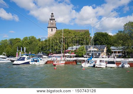 NAANTALI, FINLAND - AUGUST 27, 2016: Sunny august day in the old harbour of Naantali. Tourist landmark of the city Naantali, Finland