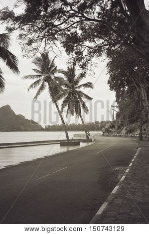 view of beautiful turning road near the sea and mountain,abstract vintage monotone filtered image