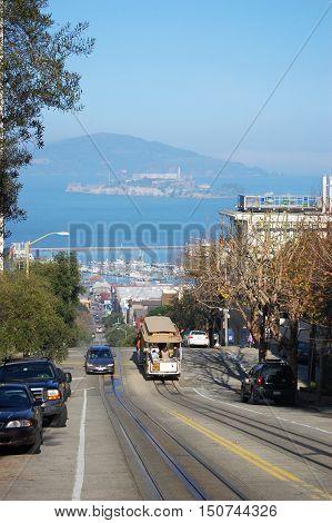 SAN FRANCISCO, CA - DEC 29: Cablecar in San Francisco, with Alcatraz in the background on December 29, 2008 in San Francisco, California, USA.