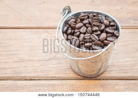 Roasted coffee beans in bucket stock photo