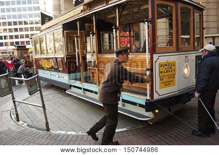 SAN FRANCISCO, CA - DEC 29: Antique Cable Car on Powell Street Turntable on December 29, 2008 in San Francisco, California, USA.