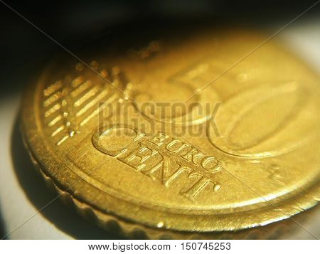 Extreme closeup of euro coin with shadow corner