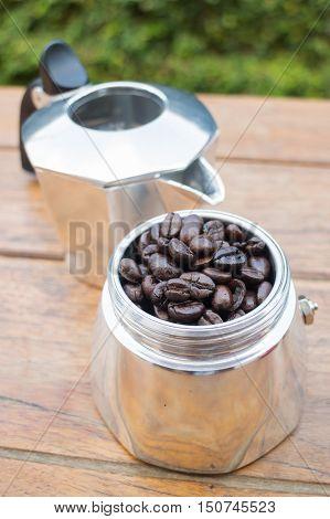 Roasted coffee beans in moka pot stock photo