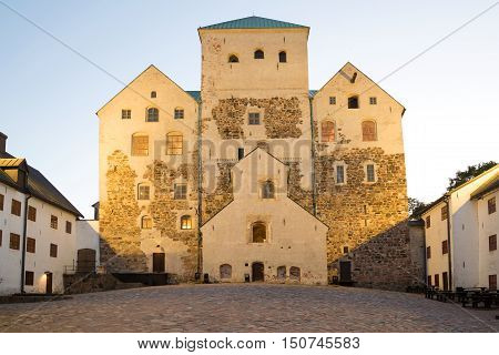 Inner courtyard of the medieval episcopal castle in the august twilight. Turku Finland