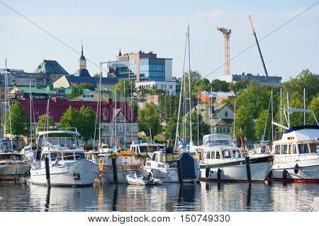 LAPPEENRANTA, FINLAND - AUGUST 21, 2016: Yachts and boats in the harbor of Lappeenranta in the early august morning