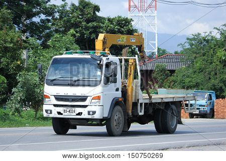 CHIANGMAI THAILAND - OCTOBER 2 2016: Private Mitsubishi Fuso Truck with Crane. Photo at road no.121 about 8 km from downtown Chiangmai thailand.