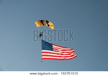 FOLSOM, CA - July 4th: US Army Skydiver with US Flag