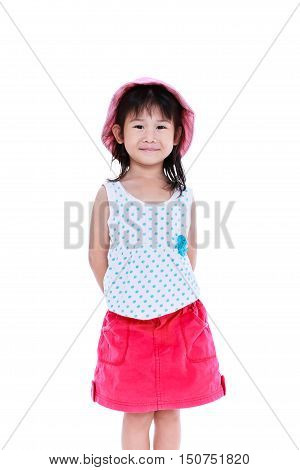 Happy asian child in pink skirt posing in the studio isolated on white background. Chinese girl smiling and looking at camera. Studio shot.