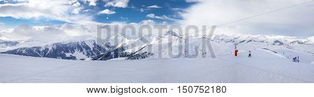 Panoramaview To Ski Slopes And Skiers Skiing In Kitzbuehel Mountain Ski Resort With A Background To