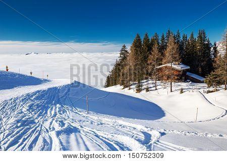 KITZBUEHEL AUSTRIA - February 18 2016 - Alpine chalet covered by snow in Kitzbuehel ski arena Austria