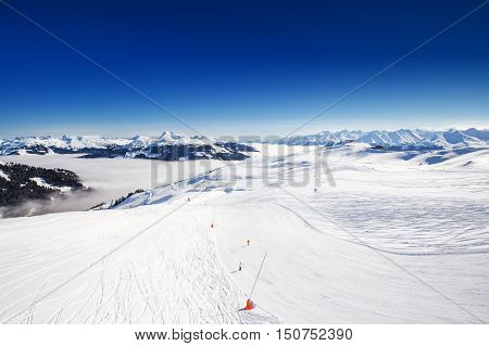View to Alpine mountains in Austria from Kitzbuehel ski resort - one of the best ski resort in the workd with 54 cable cars 170 km prepared skiing slopes and place of famous hahnenkamm races.