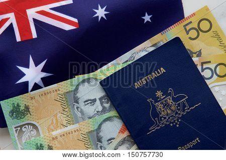 Australian passport with Australian dollars and flag.
