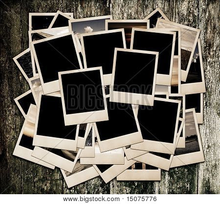 Stack of photo shots on wooden background, sepia