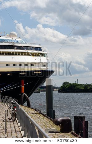 HAMBURG, GERMANY - JULY 18, 2015: the front part of cruise liner moored in the seaport. Closeup.