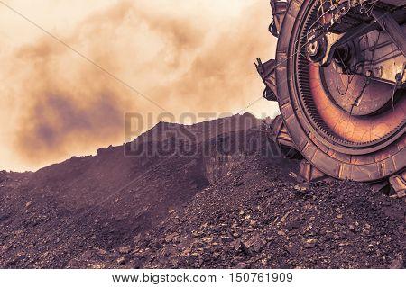 Giant bucket wheel excavator for digging the brown coal,sunset sky, Czech Republic