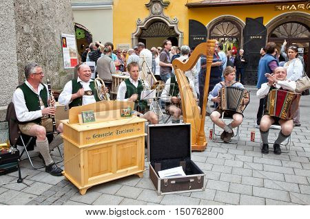 SALZBURG AUSTRIA - May 05.2012: Performance of chamber classical music on a city street. Free public entertainment concert