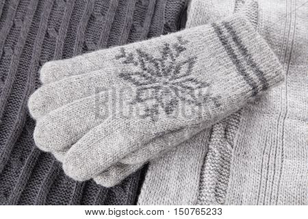 Woolen warm clothes and knitted gloves closeup