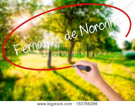 Woman Hand Writing Fernando De Noronha With A Marker Over Transparent Board