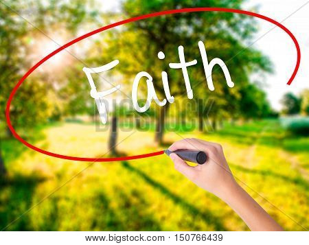 Woman Hand Writing Faith With A Marker Over Transparent Board