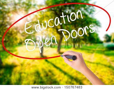 Woman Hand Writing Education Open Doors With A Marker Over Transparent Board