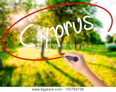 Woman Hand Writing Cyprus With A Marker Over Transparent Board
