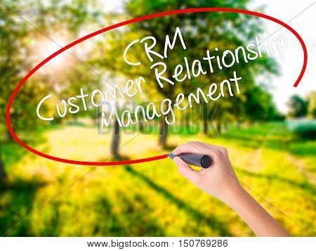 Woman Hand Writing Crm Customer Relationship Management  With A Marker Over Transparent Board