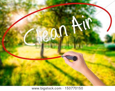 Woman Hand Writing Clean Air With A Marker Over Transparent Board