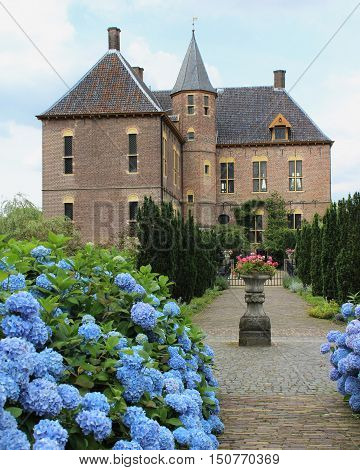 VORDEN, NETHERLANDS, JULY 16 2016: Exterior view of the 17th century castle in Vorden in Gelderland. Formerly a stately home the castle complex has been restored and is open as a hotel and venue.