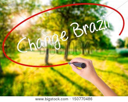 Woman Hand Writing Change Brazil  With A Marker Over Transparent Board