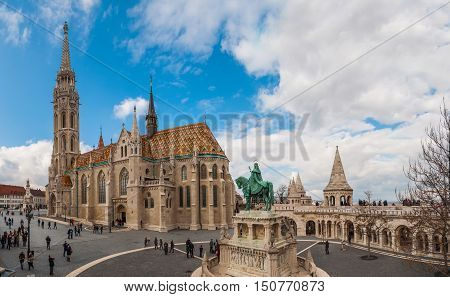 BUDAPEST HUNGARY - FEBRUARY 20 2016: Matthias Church is a Roman Catholic church located in Budapest Hungary in front of the Fisherman's Bastion at the heart of Buda's Castle District