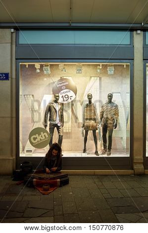 GENEVA, SWITZERLAND - NOVEMBER 18, 2015: a shop window at night. A shop window is a window in a shop displaying items for sale or otherwise designed to attract customers to the store.