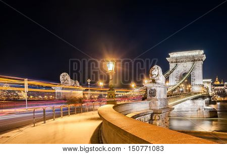 Night view of the Szechenyi Chain Bridge is a suspension bridge that spans the River Danube between Buda and Pest the western and eastern sides of Budapest the capital of Hungary.