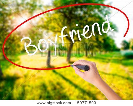 Woman Hand Writing Boyfriend With A Marker Over Transparent Board .