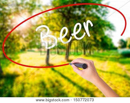 Woman Hand Writing Beer With A Marker Over Transparent Board