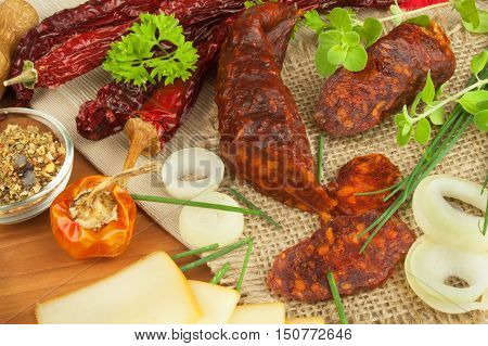 Homemade spicy pepper sausage with cheese. Homemade rustic sausages and chili. Sharp traditional food. Traditional butchers. Spicy delicacy. Advertising on butcher.