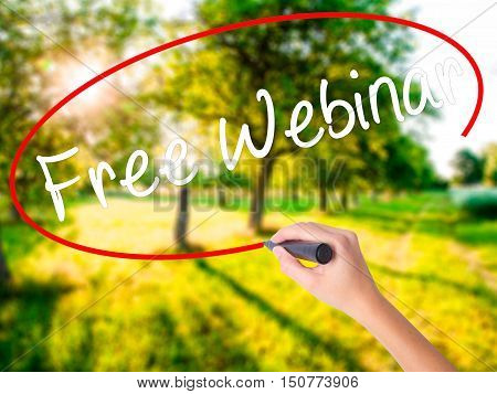 Woman Hand Writing  Free Webinar With A Marker Over Transparent Board