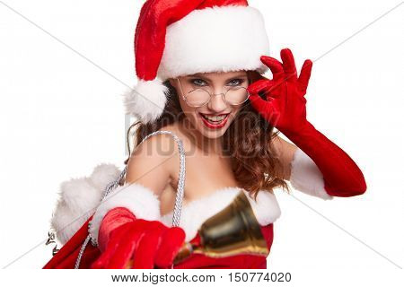christmas, x-mas, winter and people concept - smiling woman in santa helper hat with jingle bells