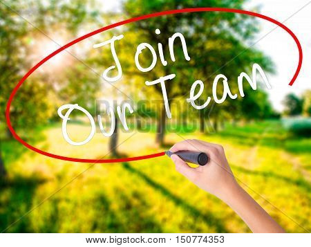 Woman Hand Writing Join Our Team With A Marker Over Transparent Board