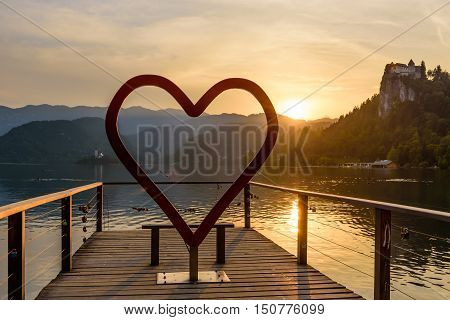 The heart symbol on the picturesque shore of Bled lake at sunset, Bled village, Slovenia.