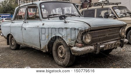 Kazakhstan, Ust-Kamenogorsk, october 5, 2016: Moskvich, old car, old soviet car in the street, moskvich 412, old battered car, sedan, very old car, old broken car