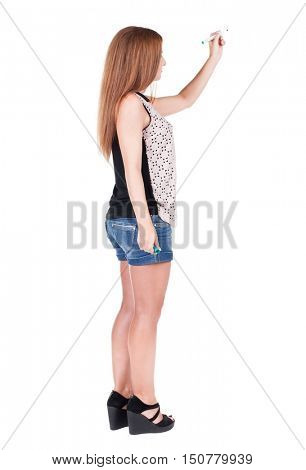 back view of writing beautiful redhead woman. Young girl in shorts draws. Rear view people collection.  backside view of person. Isolated over white background.