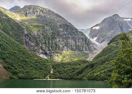 Buerbreen Glacier Seen From The Lake Down The Valley, Norway