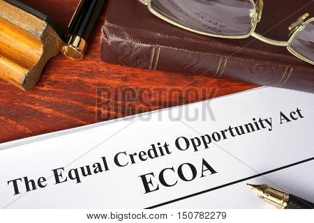 The Equal Credit Opportunity Act (ECOA) and a book.