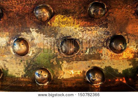 copper surface with seven hemispheres the texture of copper and black gold