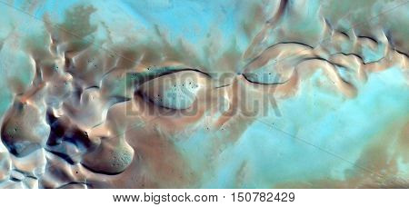 Alien eyes, fantasy in the Sahara dunes from the air, abstract landscapes of deserts africans bird's eye view, sand smooth textures bright turquoise, blue cream texture, abstract surrealism,