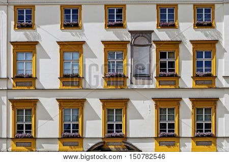 Facade of ancient tenement in the Old Town in Krakow Poland.
